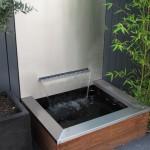 waterelement waterval RVS rivius tuinontwerp patiotuin