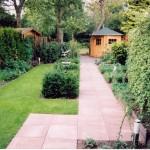 zichtlijn kunstgras taxusblokken tegels rivius tuinontwerp